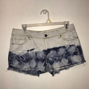 White and dip-dyed blue jean shorts